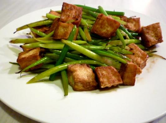 99. Stir-Fried Garlic Stem With Preserved Pork Belly