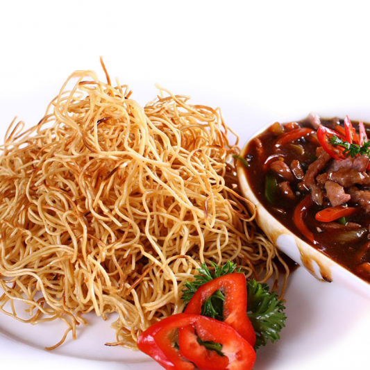 24. Shredded Beef Tenderloin with Crispy Noodle in Black Pepper Sauce.